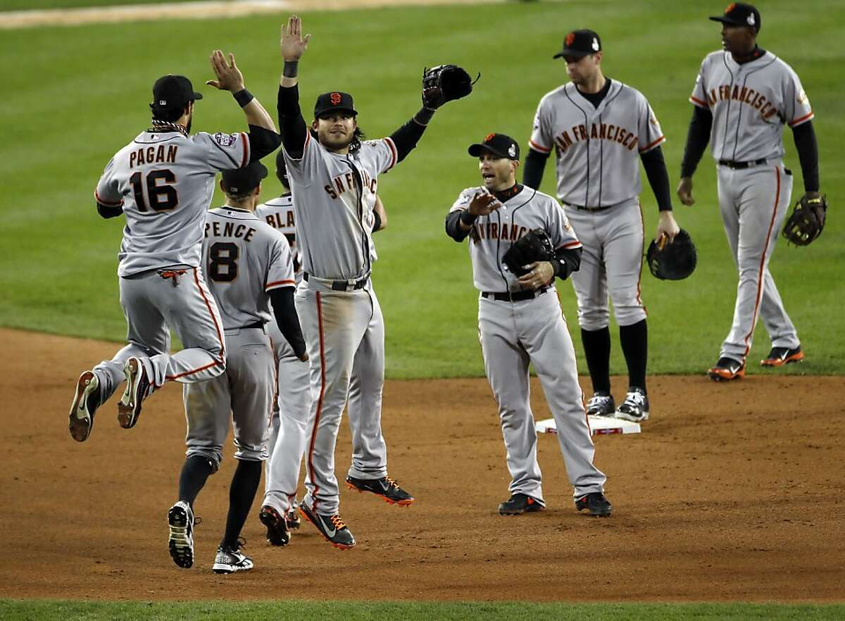 The Giants celebrate after the end of the game as they take a 3-0 lead in the World Series. The San Francisco Giants won Game 3 of the World Series against the Detroit Tigers on Saturday, October 27, 2012, in Detroit, Mi. The Giants won the game 2-0.