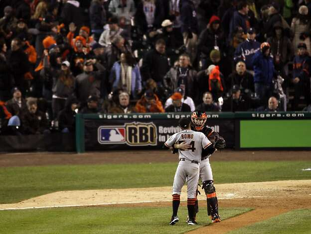 Sergio Romo and Buster Posey hug as the Giants celebrate after the end of the game as they take a 3-0 lead in the World Series. The San Francisco Giants won Game 3 of the World Series against the Detroit Tigers on Saturday, October 27, 2012, in Detroit, Mi. The Giants won the game 2-0. Photo: Carlos Avila Gonzalez, The Chronicle