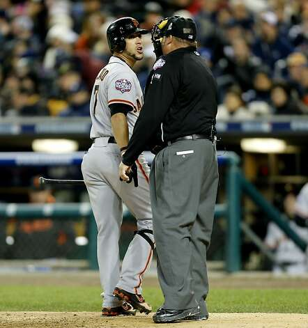 Giants' Gregor Blanco argues a call strike three in the ninth inning with home plate umpire Fieldin Culbreth, , as the San Francisco Giants went on to  beat the Detroit Tigers 2-0 to take game three of the World Series, on Saturday Oct. 27, 2012 , in Detroit, Michigan. The Giants now lead the series 3-0. Photo: Michael Macor, The Chronicle