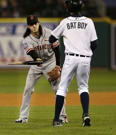 Giants' pitcher, Tim Lincecum picks up the broken bat of Miguel Cabrera, who grounded out in the eighth inning, as the San Francisco Giants beat the Detroit Tigers 2-0 to take game three of the World Series, on Saturday Oct. 27, 2012 , in Detroit, Michigan. THe gIants now lead the series 3-0. Photo: Michael Macor, The Chronicle