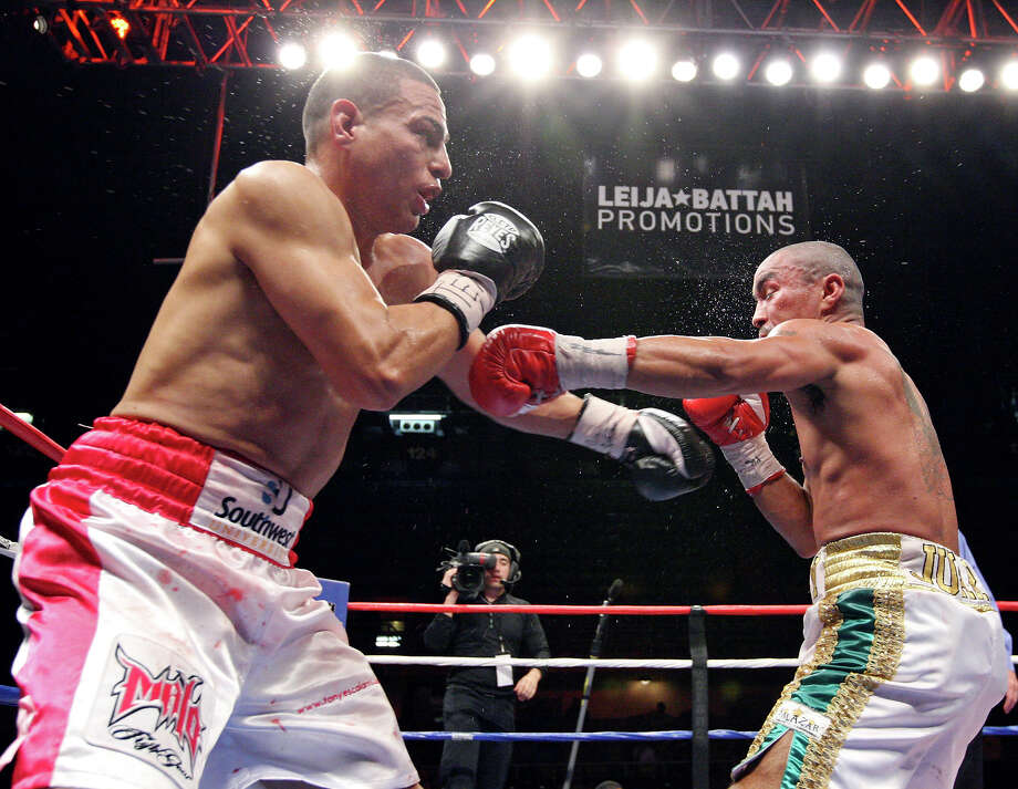 Antonio Escalante (left) and Rocky Juarez  exchange punches during the sixth round of their junior lightweight fight held Saturday Oct. 27, 2012 at the Freeman Coliseum. Juarez won with a eighth round TKO. Photo: Edward A. Ornelas, Express-News / © 2012 San Antonio Express-News