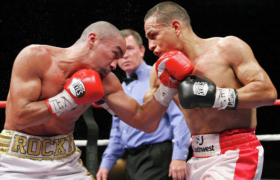 Rocky Juarez (left) and Antonio Escalante exchange punches during the seventh round of their junior lightweight fight held Saturday Oct. 27, 2012 at the Freeman Coliseum. Juarez won with a eighth round TKO. Photo: Edward A. Ornelas, Express-News / © 2012 San Antonio Express-News