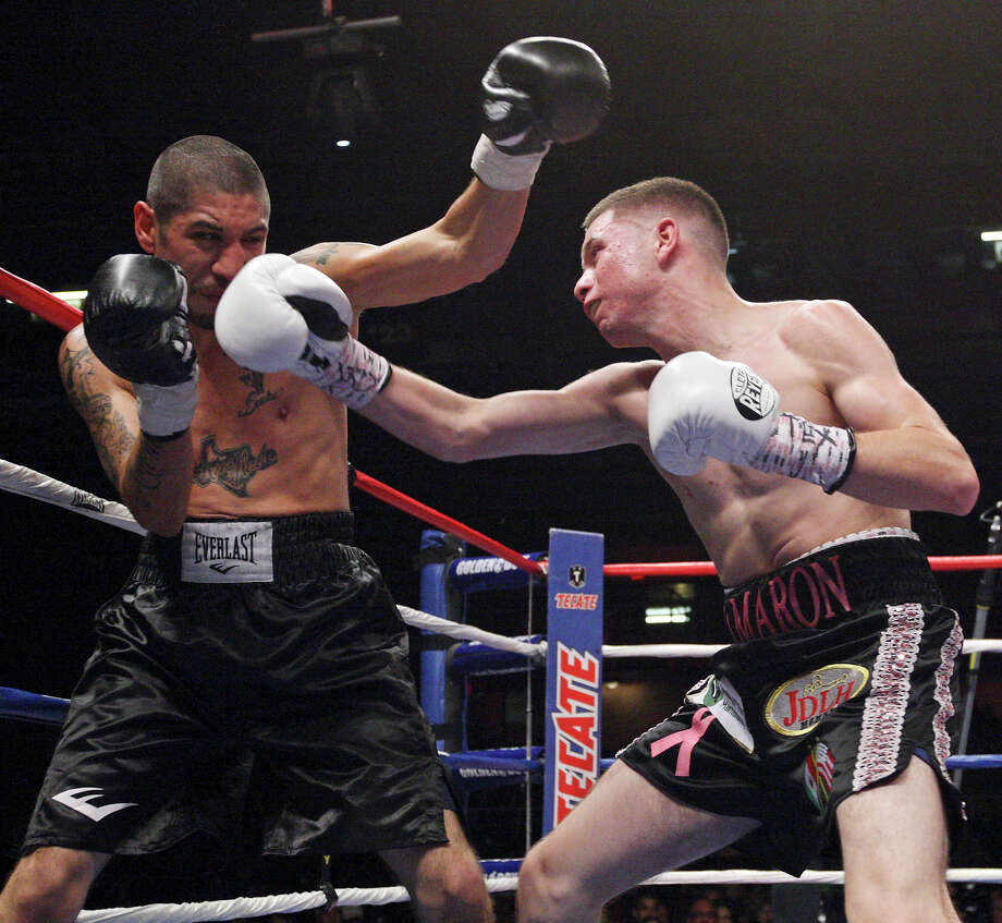 Steven Gutierrez (left) and Julian Ramirez exchange punches during the fourth round of their featherweight fight held Saturday Oct. 27, 2012 at the Freeman Coliseum. Ramirez won by TKO. Photo: Edward A. Ornelas, Express-News / © 2012 San Antonio Express-News