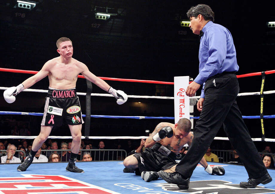 Julian Ramirez (left) reacts after Steven Gutierrez falls after being hit during the fourth round of their featherweight fight held Saturday Oct. 27, 2012 at the Freeman Coliseum. Ramirez won by TKO. Photo: Edward A. Ornelas, Express-News / © 2012 San Antonio Express-News