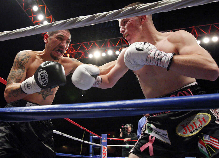 Steven Gutierrez (left) and Julian Ramirez exchange punches during the second round of their featherweight fight held Saturday Oct. 27, 2012 at the Freeman Coliseum. Ramirez won by TKO. Photo: Edward A. Ornelas, Express-News / © 2012 San Antonio Express-News