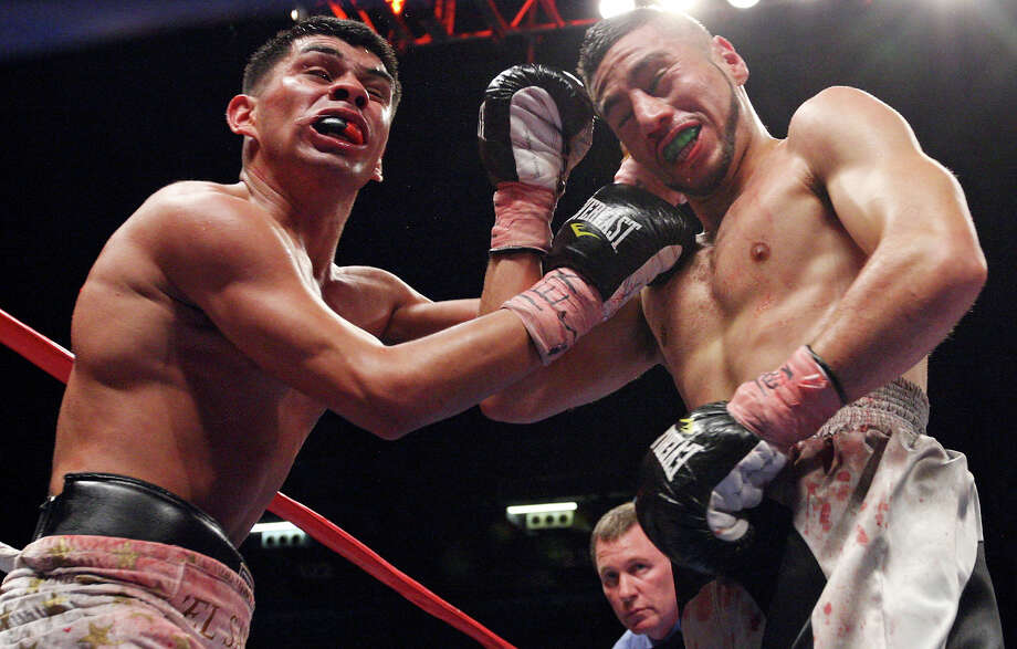 Marty Gutierrez (left) and Saul Montes exchange punches during the fourth round of their lightweight fight held Saturday Oct. 27, 2012 at the Freeman Coliseum. Gutierrez won by unanimous decision. Photo: Edward A. Ornelas, Express-News / © 2012 San Antonio Express-News