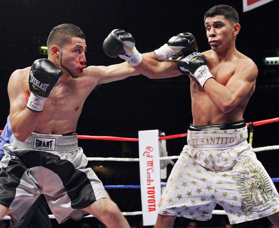 Saul Montes (left) and Marty Gutierrez exchange punches during the first round of their lightweight fight held Saturday Oct. 27, 2012 at the Freeman Coliseum. Gutierrez won by unanimous decision. Photo: Edward A. Ornelas, Express-News / © 2012 San Antonio Express-News