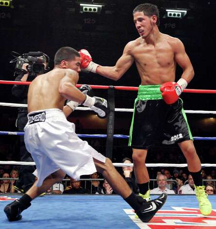 Kendo Castaneda, knocking down Albert Romero in October at Freeman Coliseum, is scheduled to fight on tonight's card. Photo: Edward A. Ornelas, Express-News / © 2012 San Antonio Express-News