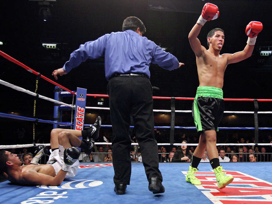 Kendo Castaneda (right) reacts after knocking down Albert Romero during the fourth round of their lightweight fight held Saturday Oct. 27, 2012 at the Freeman Coliseum. Castaneda won by unanimous decision. Photo: Edward A. Ornelas, Express-News / © 2012 San Antonio Express-News