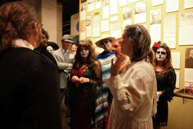 Revelers attend Dance with the Dead at the Institute of Texan Cultures on Saturday night, Oct. 27, 2012. Photo: Yvonne Zamora, MySA.com