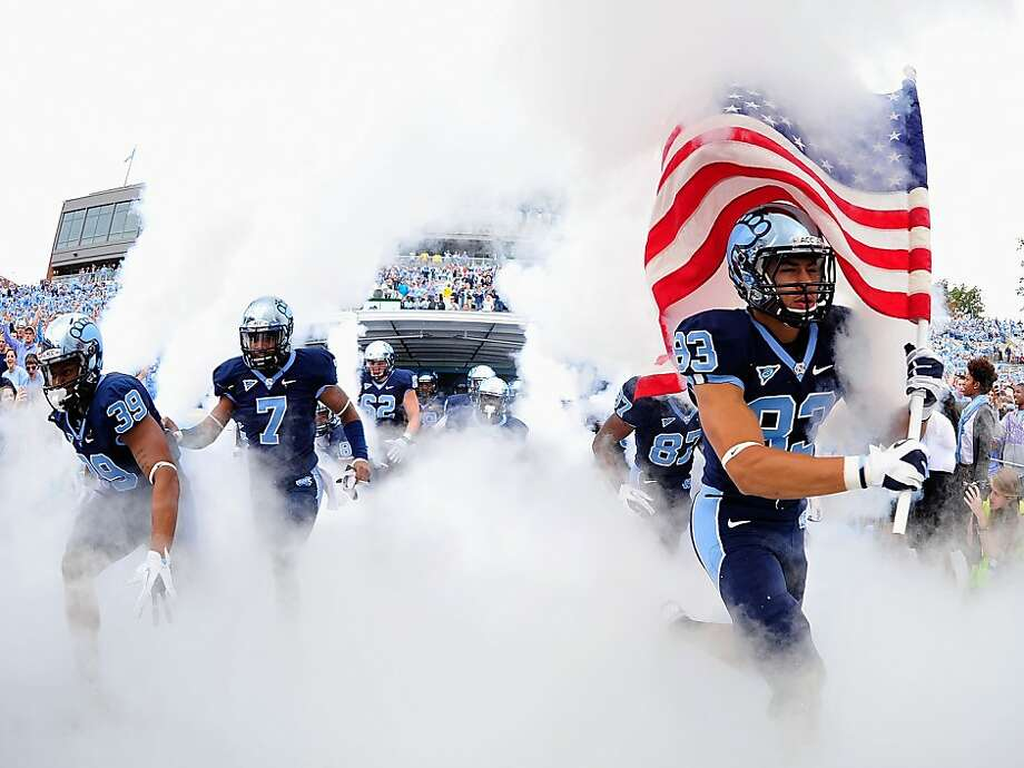 North Carolina Tar Heels players take the field for a game against the North Carolina State Wolfpack at Kenan Stadium on October 27, 2012 in Chapel Hill, North Carolina. Photo: Grant Halverson, Getty Images