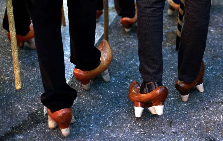 Clogs are traditional among the farmers. (AP Photo/Andres Kudacki) Photo: Andres Kudacki, Associated Press / AP