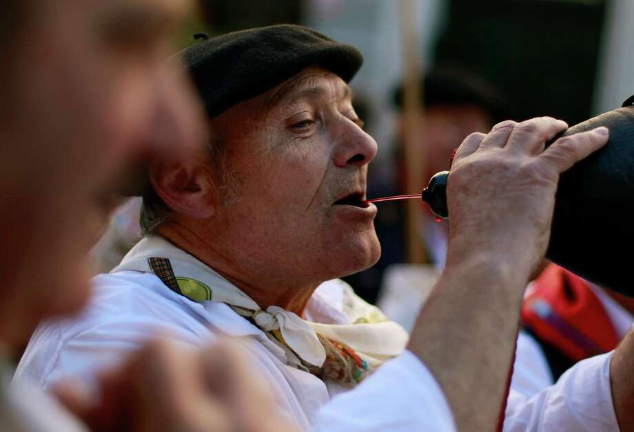 Wine is part of the ritual. Photo: Andres Kudacki, Associated Press / AP