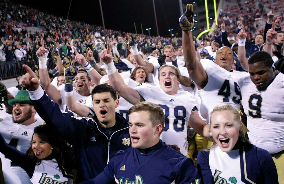Notre Dame celebrates after defeating Oklahoma 30-13 in an NCAA college football game in Norman, Okla., Saturday, Oct. 27, 2012. (AP Photo/Alonzo Adams) Photo: Alonzo Adams, FRE / FR159426 AP