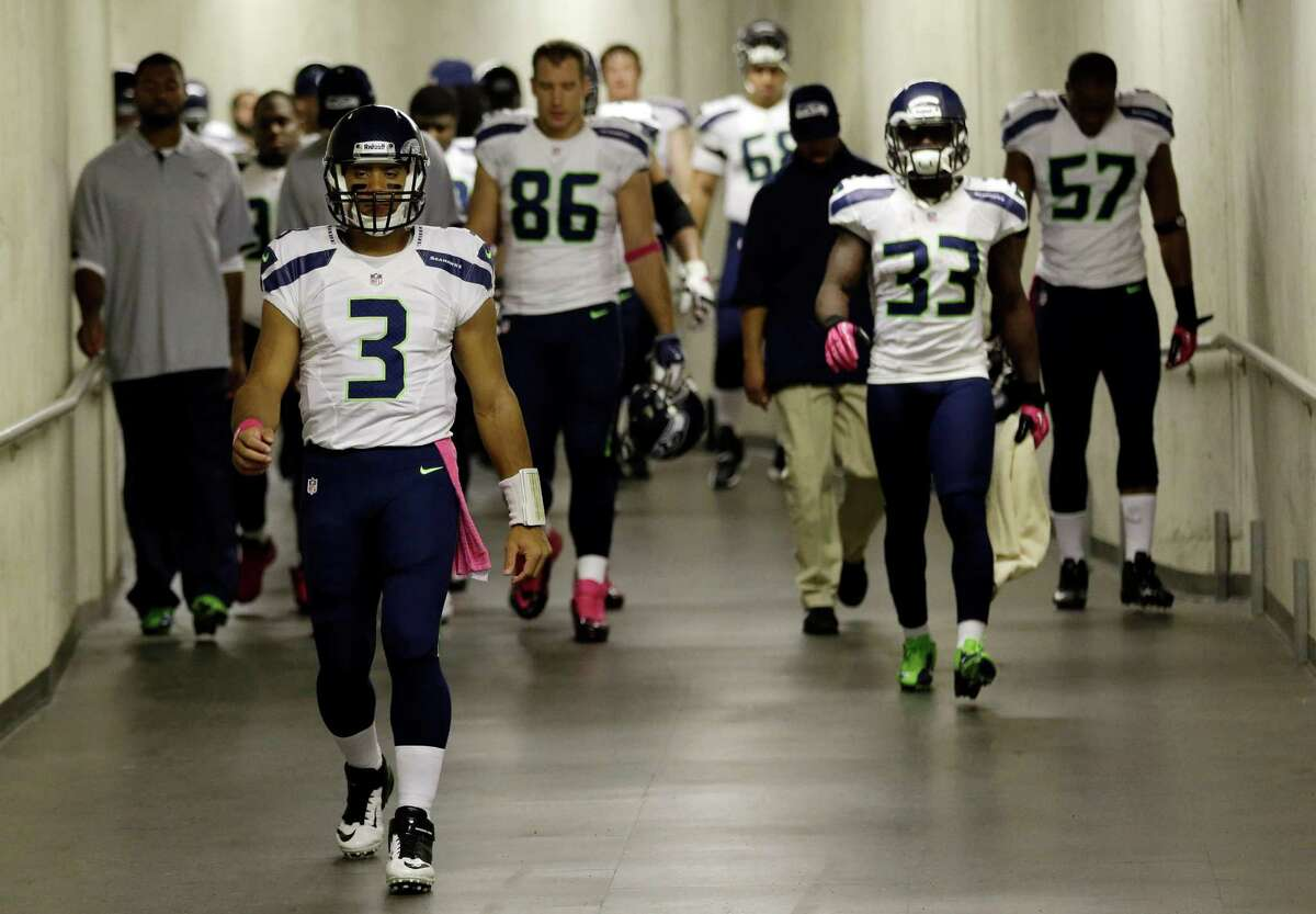 Seattle Seahawks quarterback Russell Wilson (3) leads the team as as the Seahawks walk down on the tunnel for the start of an NFL football game against the Detroit Lions, Sunday, Oct. 28, 2012. in Detroit.