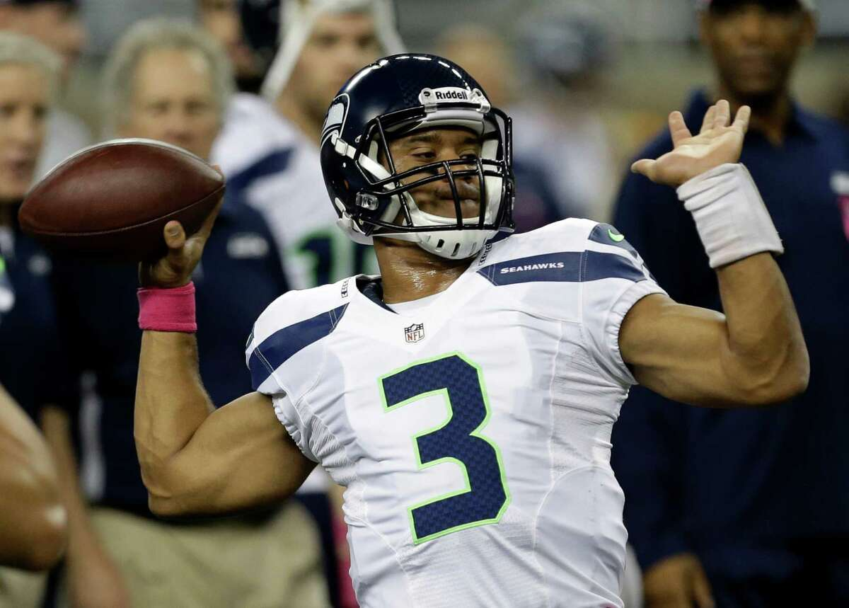 Seattle Seahawks quarterback Russell Wilson (3) warms up before an NFL football game against the Detroit Lions, Sunday, Oct. 28, 2012. in Detroit.