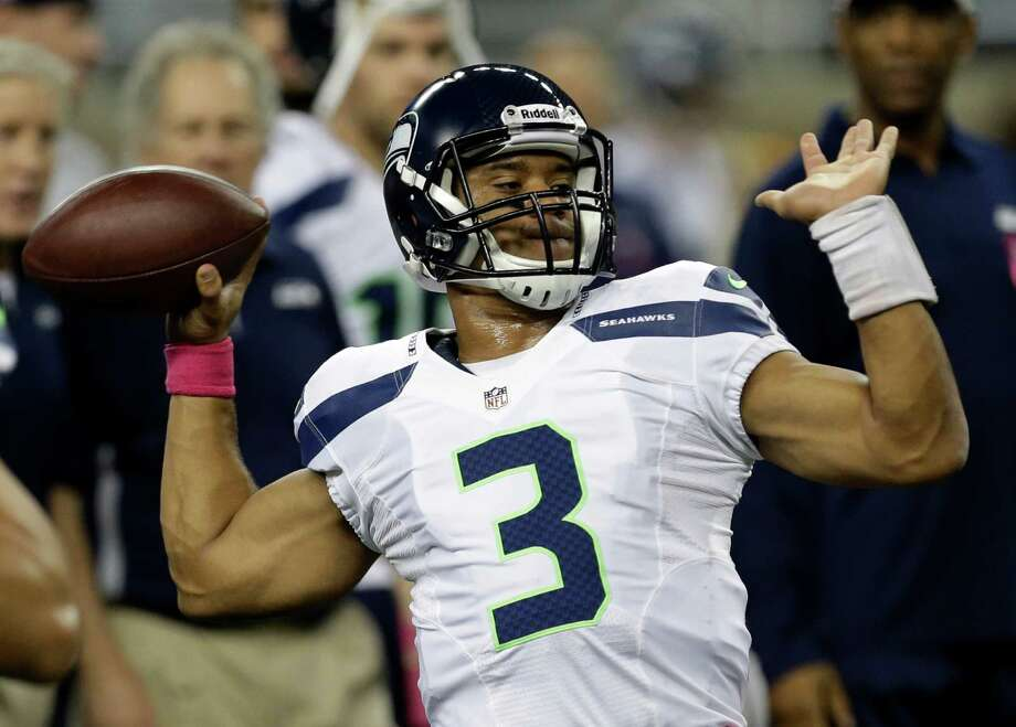 Seattle Seahawks quarterback Russell Wilson (3) warms up before an NFL football game against the Detroit Lions, Sunday, Oct. 28, 2012. in Detroit. Photo: AP