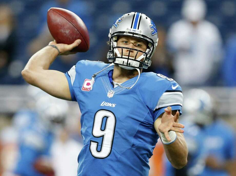 Detroit Lions quarterback Matthew Stafford (9) warms up before an NFL football game against the Seattle Seahawks, Sunday, Oct. 28, 2012. in Detroit. Photo: AP