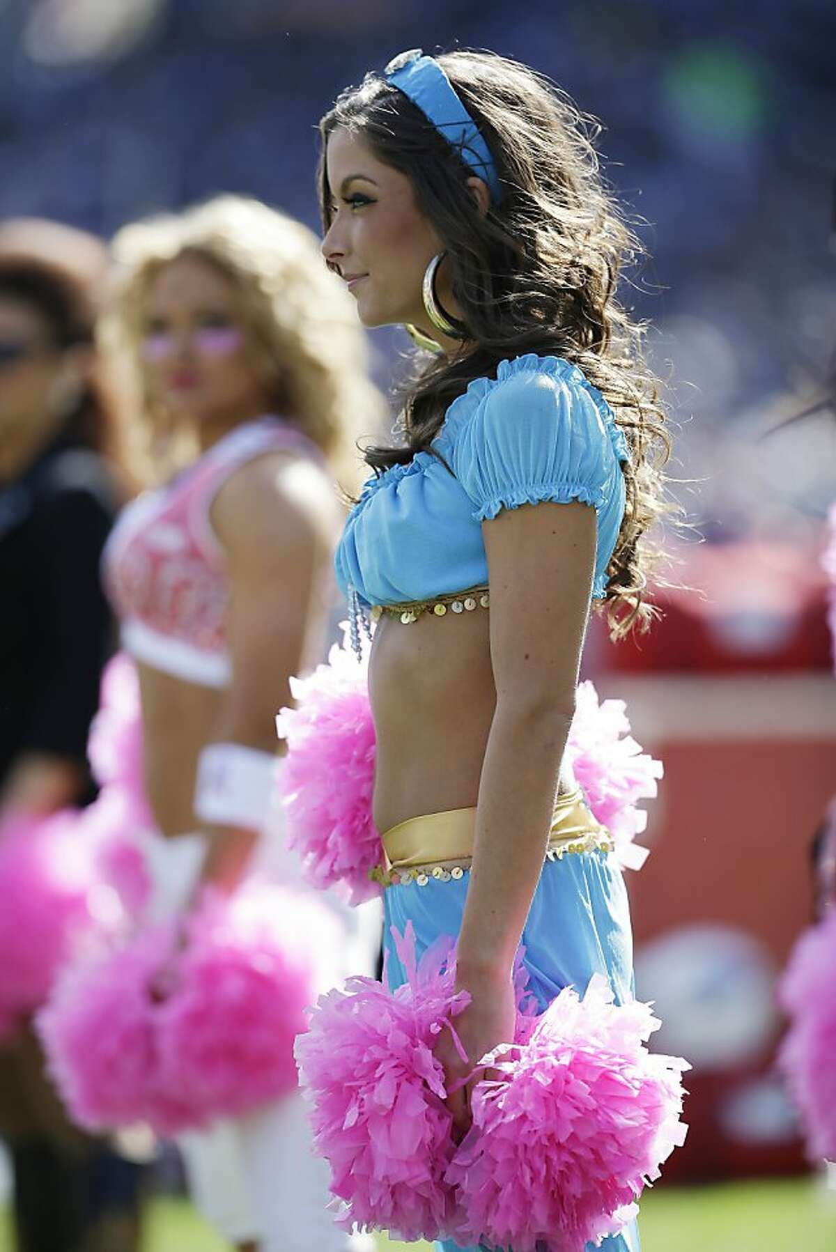 Tennessee Titans cheerleaders perform while wearing Halloween costumes during the first half of an NFL football game against the Indianapolis Colts, Sunday, Oct. 28, 2012, in Nashville, Tenn. (AP Photo/Mark Humphrey)