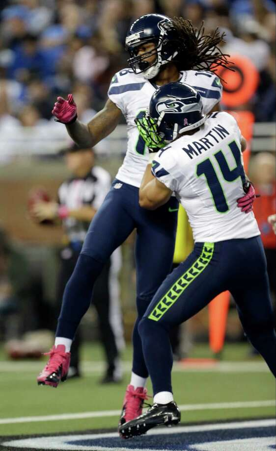 Seattle Seahawks wide receiver Sidney Rice (18) celebrates his touchdown with wide receiver Charly Martin (14) in the first half of an NFL football game against the Detroit Lions, Sunday, Oct. 28, 2012. in Detroit. Photo: AP