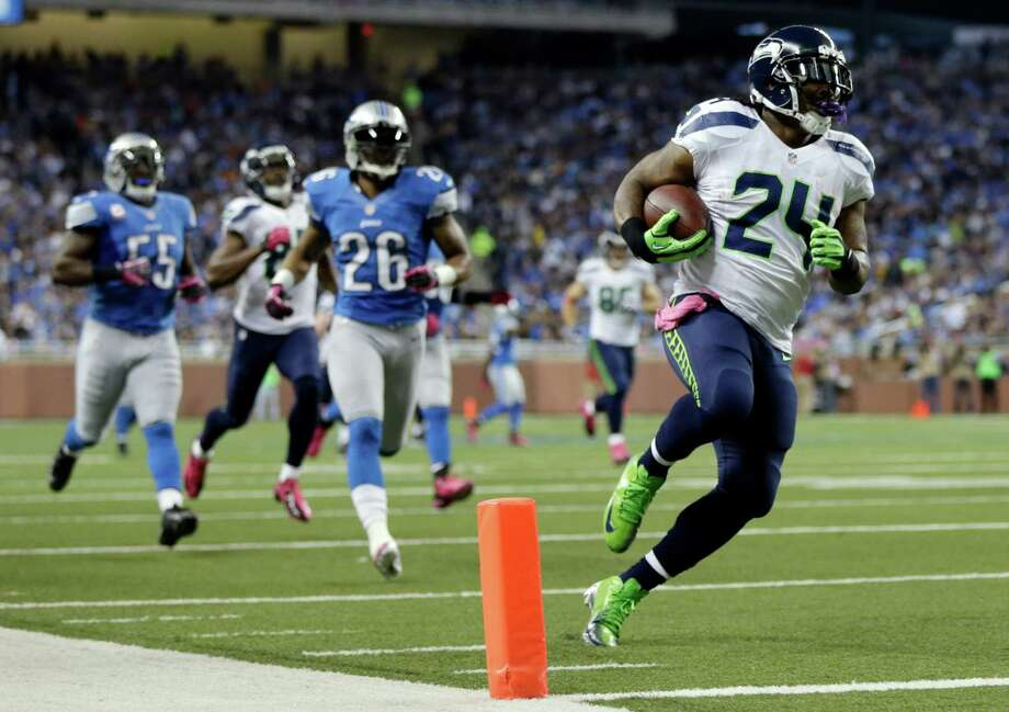 Seattle Seahawks running back Marshawn Lynch (24) makes a touchdown run in the first half of an NFL football game against the Detroit Lions, Sunday, Oct. 28, 2012. in Detroit. Photo: AP