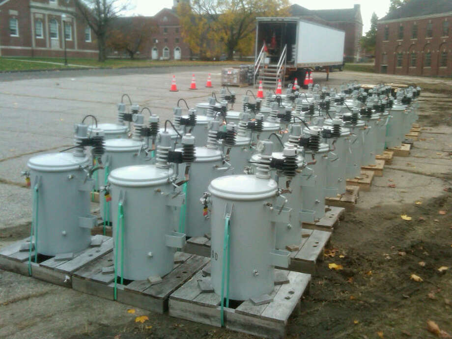 Dozens of replacement transformers at the staging area at Fairfield Hills in Newtown. Photo: Tom Baden