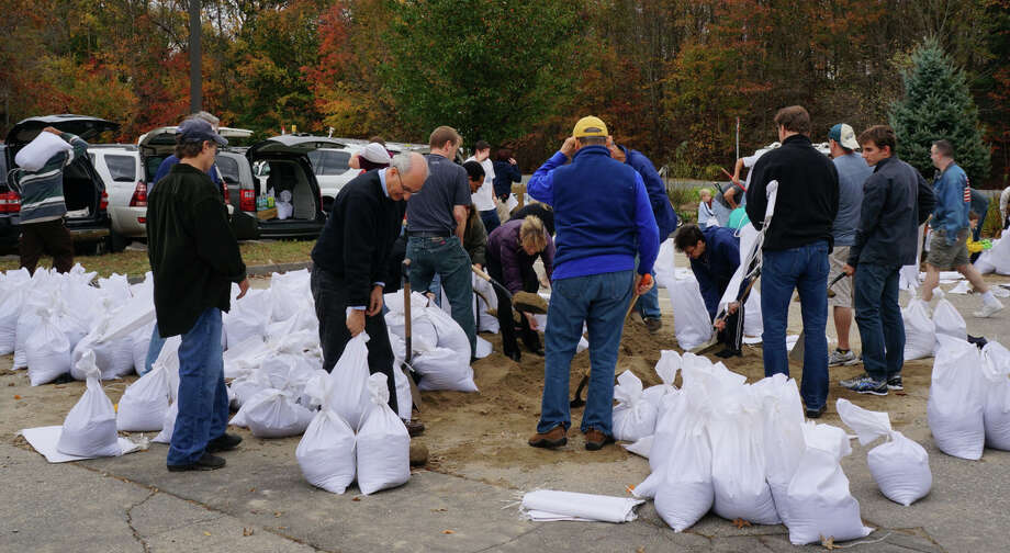 Sand bag-making frenzy Sunday at the Department of Public Works yard. Photo: Paul Schott