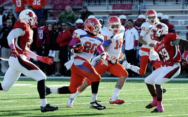 SHSU running back Timothy Flanders makes a 52 yard run for a SHSU touchdown during the football game between Lamar University and Sam Houston State University at Provost Umphrey Stadium on Saturday, October 27, 2012. Photo taken: Randy Edwards/The Enterprise Photo: Randy Edwards