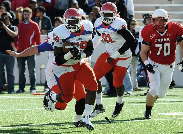SHSU defensive lineman  J.T. Cleveland picks a fumble at the Cardinals 10 yard line during the football game between Lamar University and Sam Houston State University at Provost Umphrey Stadium on Saturday, October 27, 2012. Photo taken: Randy Edwards/The Enterprise Photo: Randy Edwards