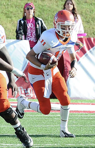 SHSU quarterback Brian Bell on a quarterback keeper during the football game between Lamar University and Sam Houston State University at Provost Umphrey Stadium on Saturday, October 27, 2012. Photo taken: Randy Edwards/The Enterprise Photo: Randy Edwards