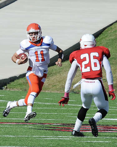 SHSU quarterback Brian Bell, 11, with a quarterback keeper for a first down during the football game between Lamar University and Sam Houston State University at Provost Umphrey Stadium on Saturday, October 27, 2012. Photo taken: Randy Edwards/The Enterprise Photo: Randy Edwards