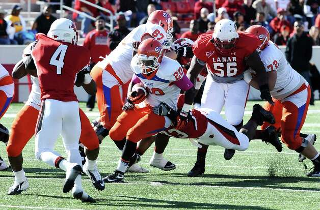 SHSU running back Timothy Flanders pushes for a first down during the football game between Lamar University and Sam Houston State University at Provost Umphrey Stadium on Saturday, October 27, 2012. Photo taken: Randy Edwards/The Enterprise Photo: Randy Edwards