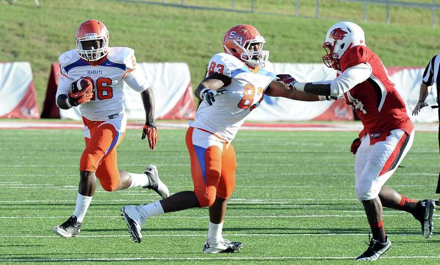 SHSU running back Keshawn Hill takes a pitch to gain another SHSU first down during the football gam