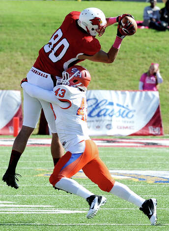 Lamar tight end Cory Soto makes a great catch for another Cardinal first down during the football game between Lamar University and Sam Houston State University at Provost Umphrey Stadium on Saturday, October 27, 2012. Photo taken: Randy Edwards/The Enterprise Photo: Randy Edwards