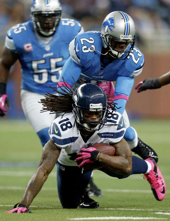 Detroit Lions cornerback Chris Houston (23) tackles Seattle Seahawks wide receiver Sidney Rice (18) in the first half of an NFL football game, Sunday, Oct. 28, 2012, in Detroit. Photo: AP