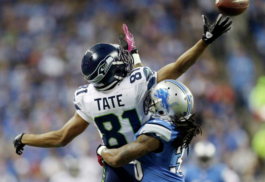 Detroit Lions cornerback Jonte Green (36) breaks up a pass intended for Seattle Seahawks wide receiver Golden Tate (81) in the first half of an NFL football game, Sunday, Oct. 28, 2012. in Detroit. Pass interference was called against Green on the play. Photo: AP