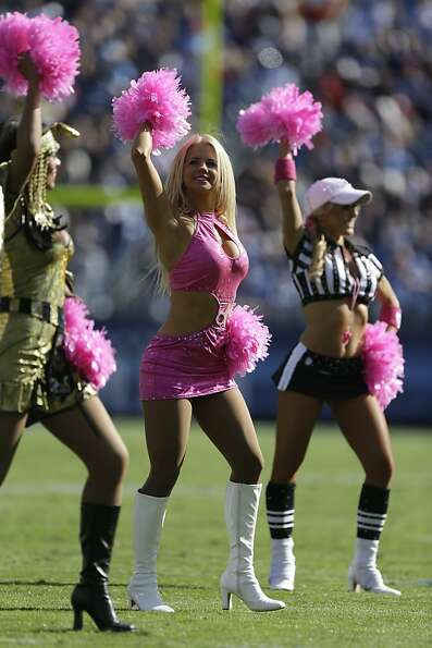 Tennessee Titans cheerleaders perform while wearing Halloween costumes during the second half of an