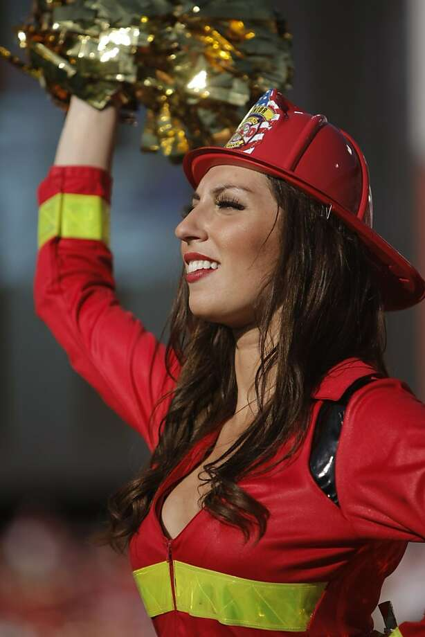 A San Francisco 49ers cheerleader dresses for Halloween during the game against the Cleveland Browns at Candlestick Park in San Francisco, Calif., on Sunday, Oct. 30, 2011.  The 49ers beat the Browns, 20-10. Photo: Dylan Entelis, The Chronicle