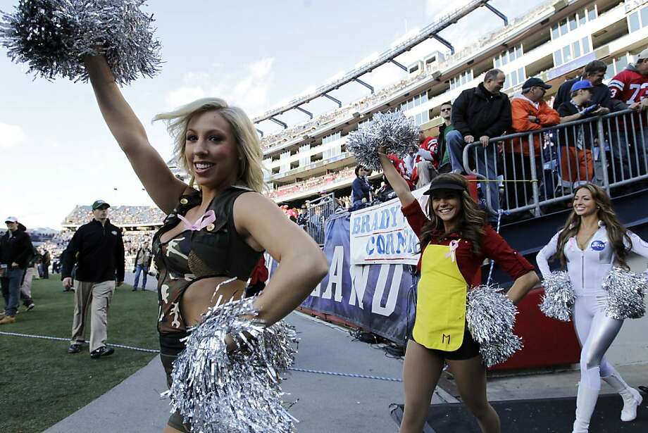 New England Patriots cheerleaders, dressed in Halloween costumes, take the field before an NFL football game between the New England Patriots and the New York Jets in Foxborough, Mass., Sunday, Oct. 21, 2012. (AP Photo/Elise Amendola) Photo: Elise Amendola, Associated Press