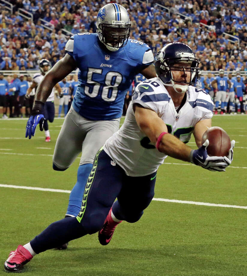 Seattle Seahawks tight end Zach Miller (86) makes a touchdown reception in the end zone against Detroit Lions linebacker Ashlee Palmer (58) in the second half of an NFL football game, Sunday, Oct. 28, 2012, in Detroit. Photo: AP