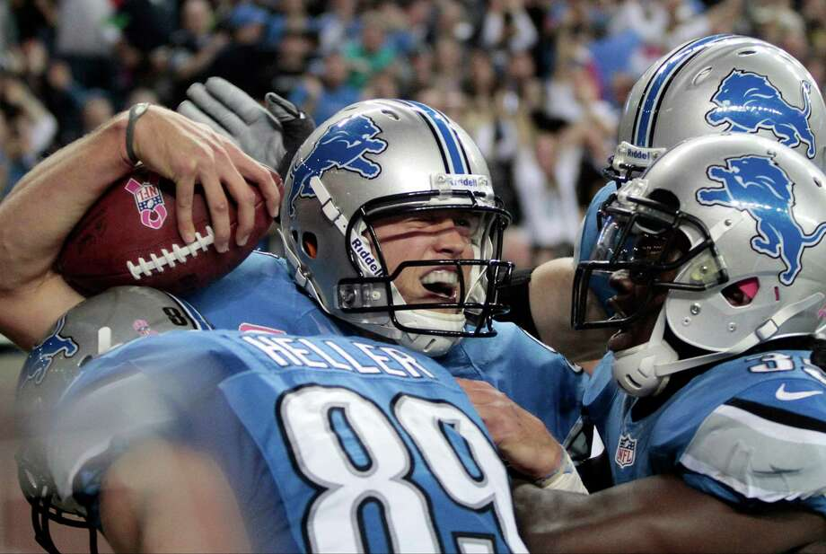 Detroit Lions quarterback Matthew Stafford (9) celebrates his touchdown run in the second half of an NFL football game against Seattle Seahawks, Sunday, Oct. 28, 2012. in Detroit. Photo: AP
