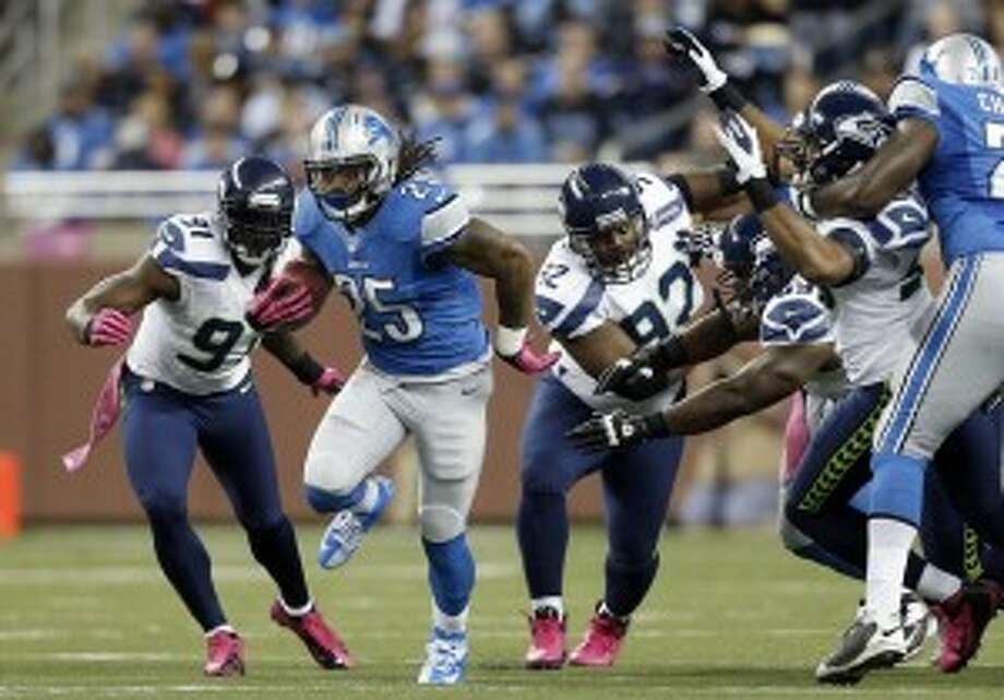 Lions RB Mikel Leshoure (25) runs against the Seahawks in the first half. (Rick Osentoski/AP Photo)View photo gallery