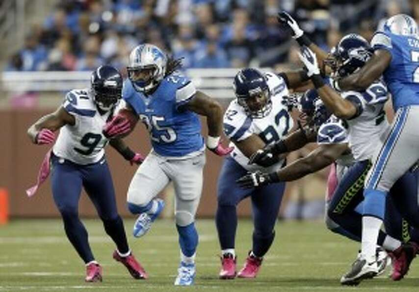 Lions RB Mikel Leshoure (25) runs against the Seahawks in the first half. (Rick Osentoski/AP Photo)