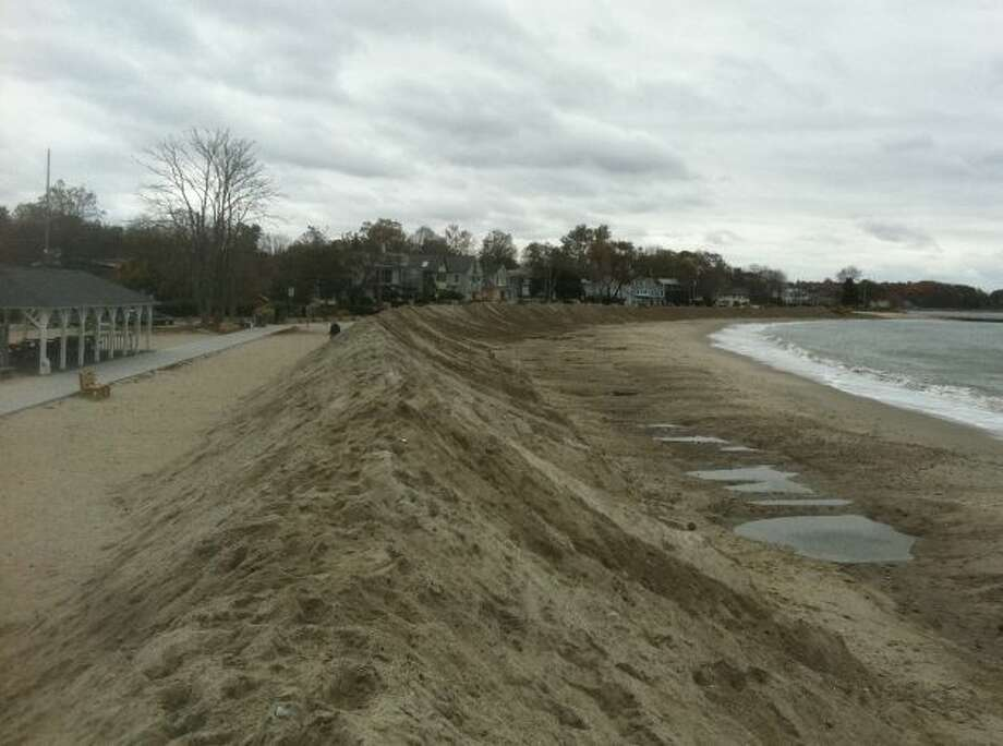 A barrier of sand is set up to offset anticipated flooding.