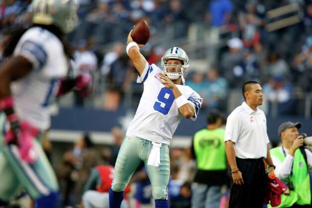 Dallas Cowboys quarterback Tony Romo (9) warms up before an NFL football game against the New York Giants, Sunday, Oct. 28, 2012 in Arlington, Texas. (AP Photo/Sharon Ellman) Photo: Sharon Ellman, Associated Press / FR170032 AP