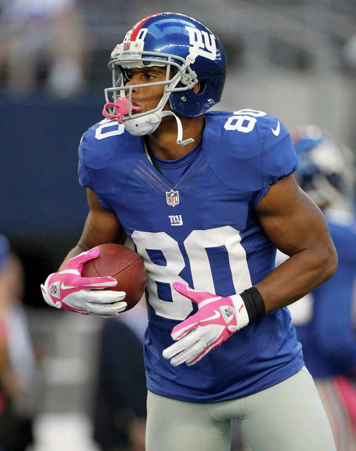 New York Giants wide receiver Victor Cruz (80) warms up before an NFL football game against the Dallas Cowboys Sunday, Oct. 28, 2012 in Arlington, Texas. (AP Photo/Tony Gutierrez) Photo: Tony Gutierrez, Associated Press / AP