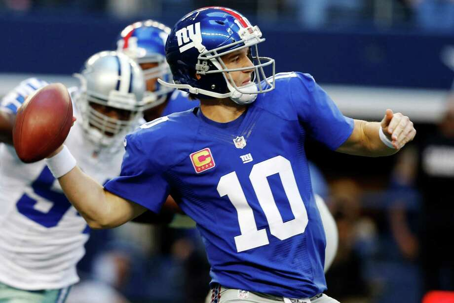 New York Giants quarterback Eli Manning (10) passes the ball against the Dallas Cowboys during the first half of an NFL football game, Sunday, Oct. 28, 2012, in Arlington, Texas. (AP Photo/Sharon Ellman) Photo: Sharon Ellman, Associated Press / FR170032 AP