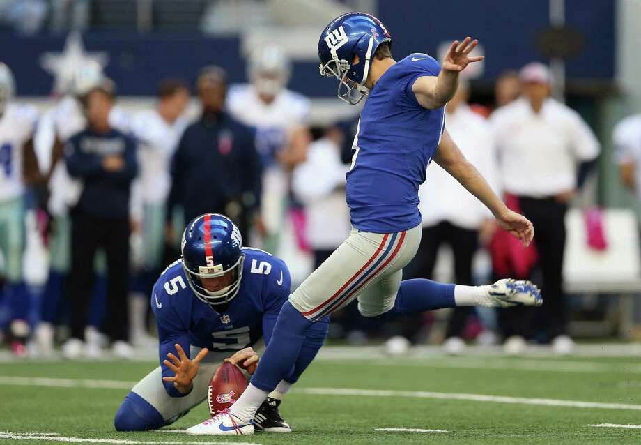 ARLINGTON, TX - OCTOBER 28:   Lawrence Tynes #9 of the New York Giants kicks a field goal against the Dallas Cowboys at Cowboys Stadium on October 28, 2012 in Arlington, Texas. Photo: Ronald Martinez, Getty Images / 2012 Getty Images