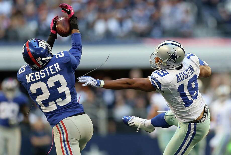 ARLINGTON, TX - OCTOBER 28:   Corey Webster #23 of the New York Giants makes a pass interception intended for Miles Austin #19 of the Dallas Cowboys at Cowboys Stadium on October 28, 2012 in Arlington, Texas. Photo: Ronald Martinez, Getty Images / 2012 Getty Images