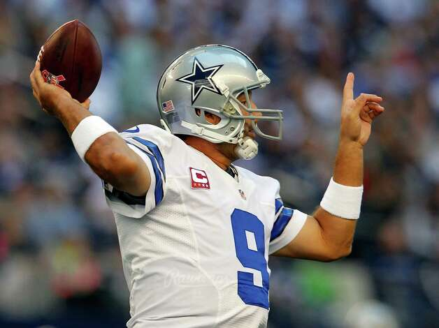 ARLINGTON, TX - OCTOBER 28:  Tony Romo #9 of the Dallas Cowboys looks for an open receiver against the New York Giants at Cowboys Stadium on October 28, 2012 in Arlington, Texas. Photo: Tom Pennington, Getty Images / 2012 Getty Images